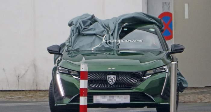 Фотошпионы поймали в объектив новый Peugeot 308 1