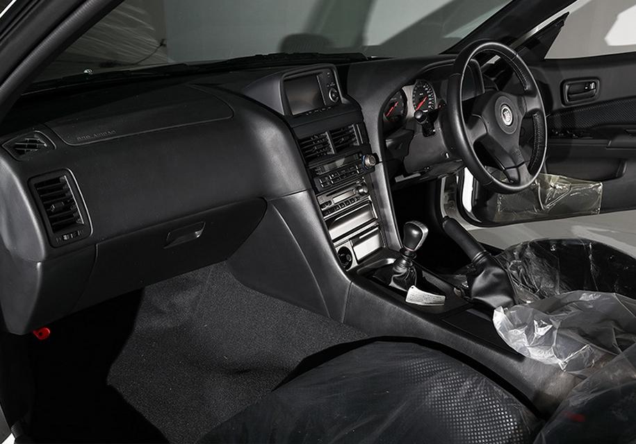 Редкий Nissan Skyline GT-R в заводской пленке пустят с молотка 3