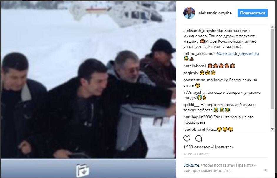 Невиданное зрелище: Игорь Коломойский толкает застрявший в снегу автомобиль 1