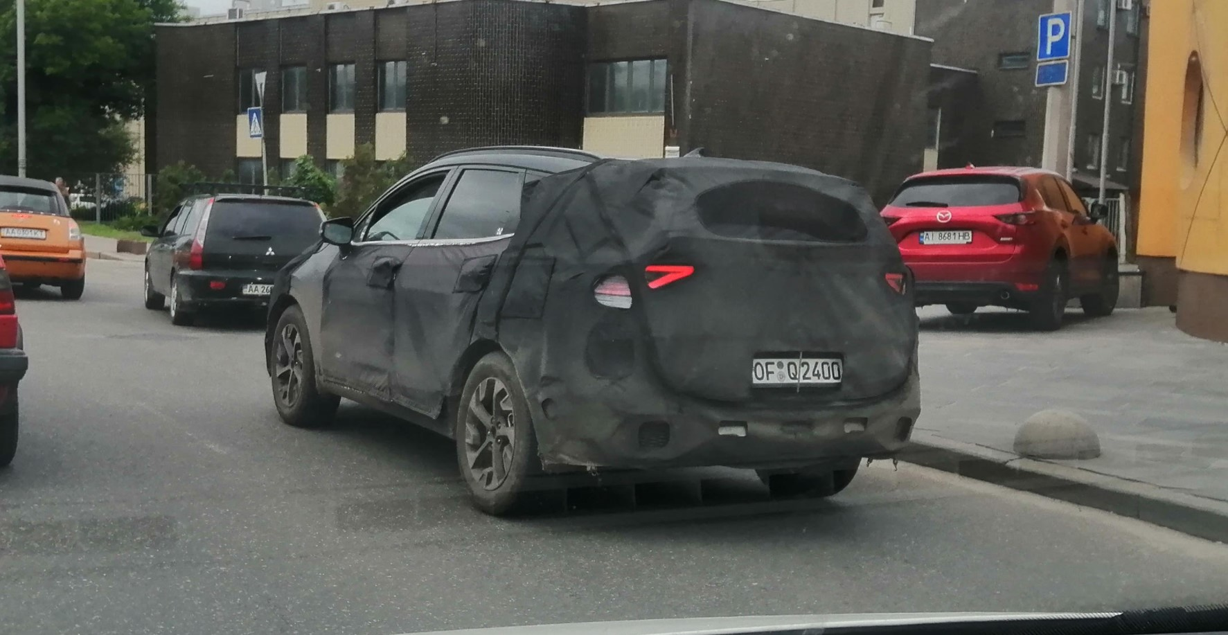 В Киеве в полном камуфляже заметили Kia Sportage пятого поколения  2